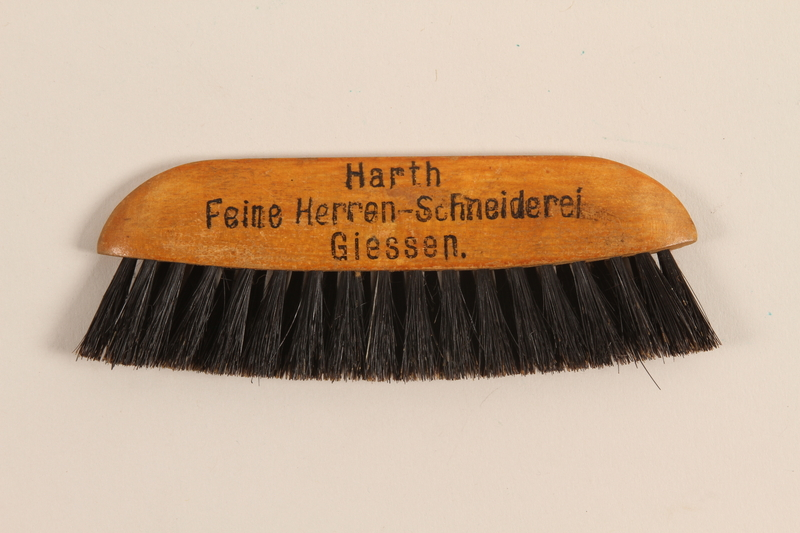 1995.123.1 front Brush imprinted with advertisement of German custom tailor shop