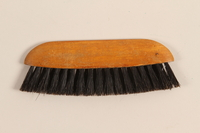 1995.123.1 back Brush imprinted with advertisement of German custom tailor shop  Click to enlarge