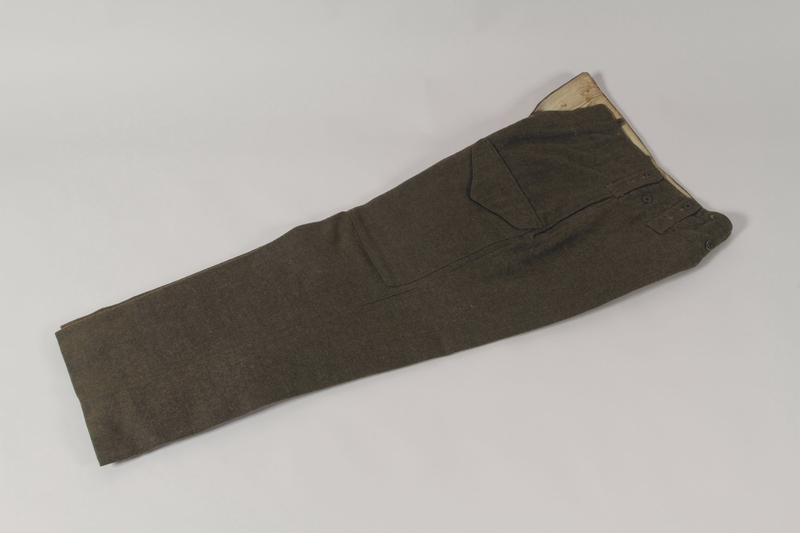 1991.119.1 b front Military blouse, trousers, and General Service Cap worn by a Dutch Jewish corporal in the Prinses Irene Brigade