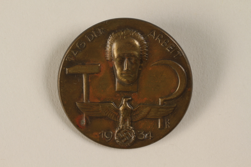 1994.124.3 front Tag der Arbeit 1934 badge