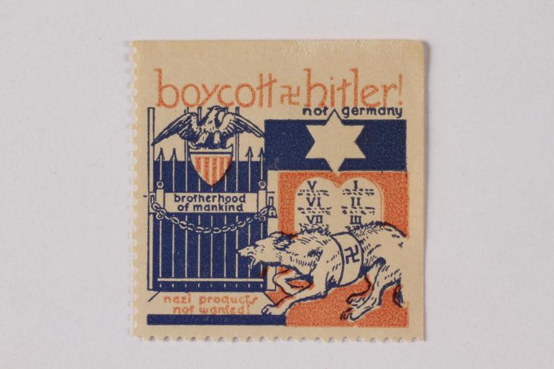 2014.505.1 front US anti-Nazi boycott stamp with a Star of David and a Nazi wolf