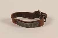 1989.188.1 front Leather ID bracelet with tag worn by a concentration camp inmate  Click to enlarge
