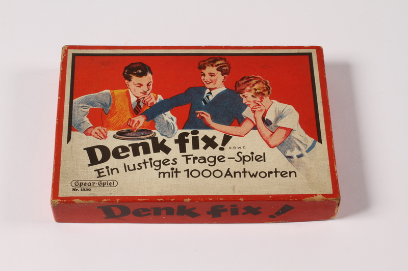 2013.495.2 a top Denk fix! [Think Quick] game turntable spinner, cards, and box brought with a young German Jewish refugee