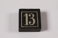 2013.495.4 j top Twelve numbered tiles and box for a game brought with a young German Jewish refugee  Click to enlarge