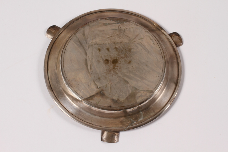 2013.496.2 bottom Silver plated ashtray with an engraving of Skansen Kronan acquired by a former concentration camp inmate