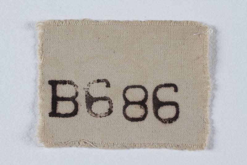 1995.128.170 front Prisoner identification badge