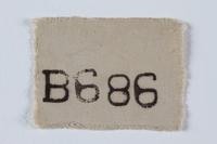 1995.128.170 front Prisoner identification badge  Click to enlarge