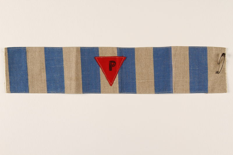 1995.128.195 front Blue and white striped armband with a red triangle with a P
