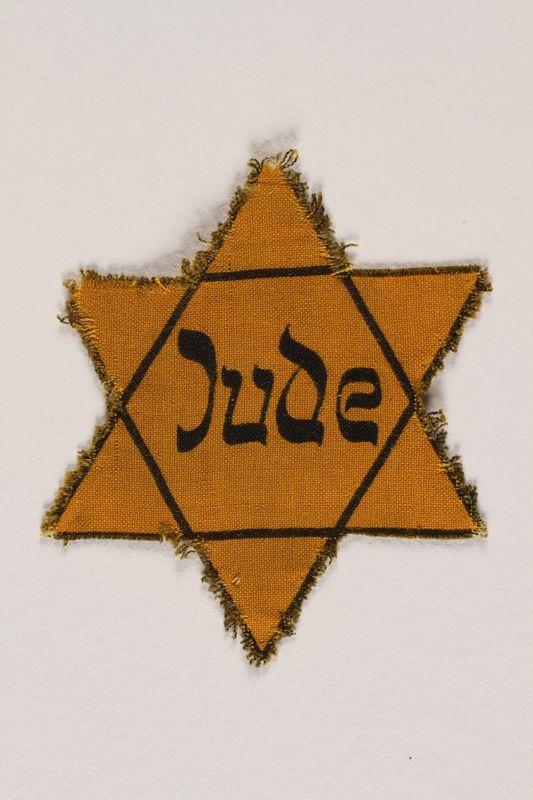 1989.205.1 front Star of David badge with Jude printed in the center