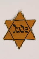 1989.205.1 front Star of David badge with Jude printed in the center  Click to enlarge