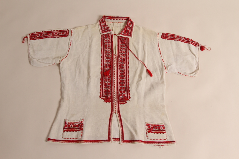 2014.535.1 front Embroidered blouse worn by a concentration camp inmate after liberation
