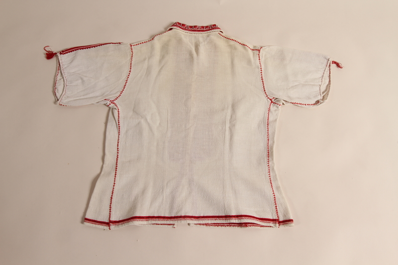 2014.535.1 back Embroidered blouse worn by a concentration camp inmate after liberation