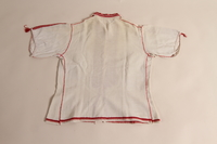 2014.535.1 back Embroidered blouse worn by a concentration camp inmate after liberation  Click to enlarge