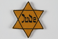 1989.205.2 front Star of David badge with Jude printed in the center  Click to enlarge