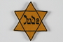 Star of David badge with Jude printed in the center