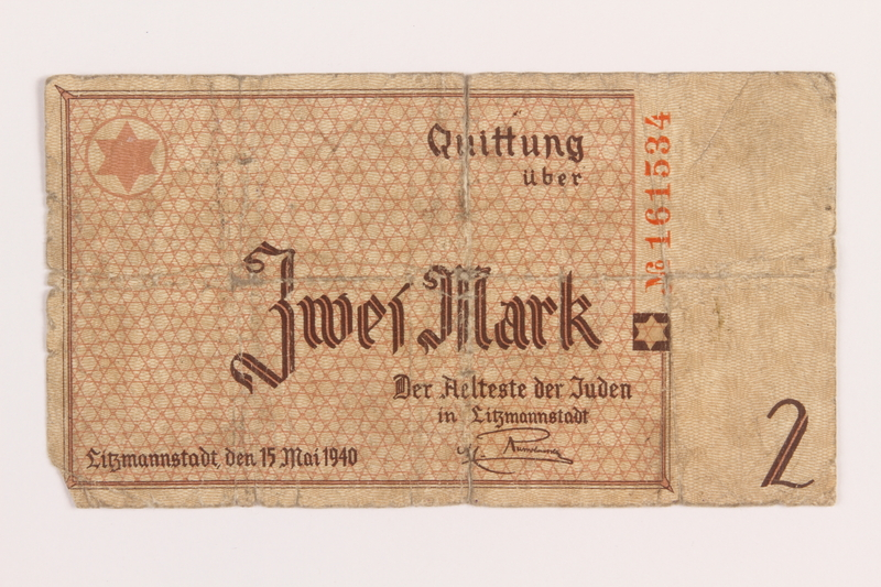 1989.207.10 front Łódź ghetto scrip, 2 mark note, acquired by a Polish Jewish survivor