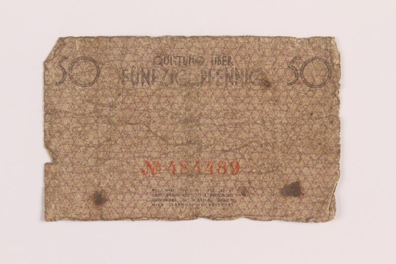 1989.207.3 back Łódź ghetto scrip, 50 pfennig note, acquired by a Polish Jewish survivor