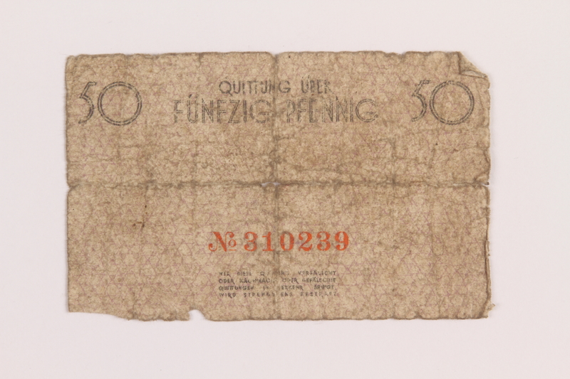 1989.207.5 back Łódź ghetto scrip, 50 pfennig note, acquired by a Polish Jewish survivor