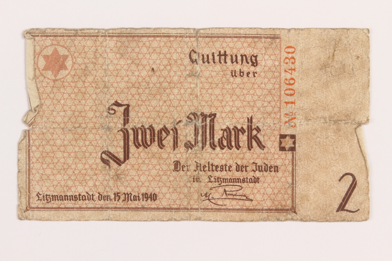 1989.207.9 front Lodz ghetto scrip, 2 mark note, acquired by a Polish Jewish survivor