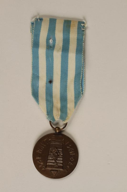 1995.128.5 front Medal