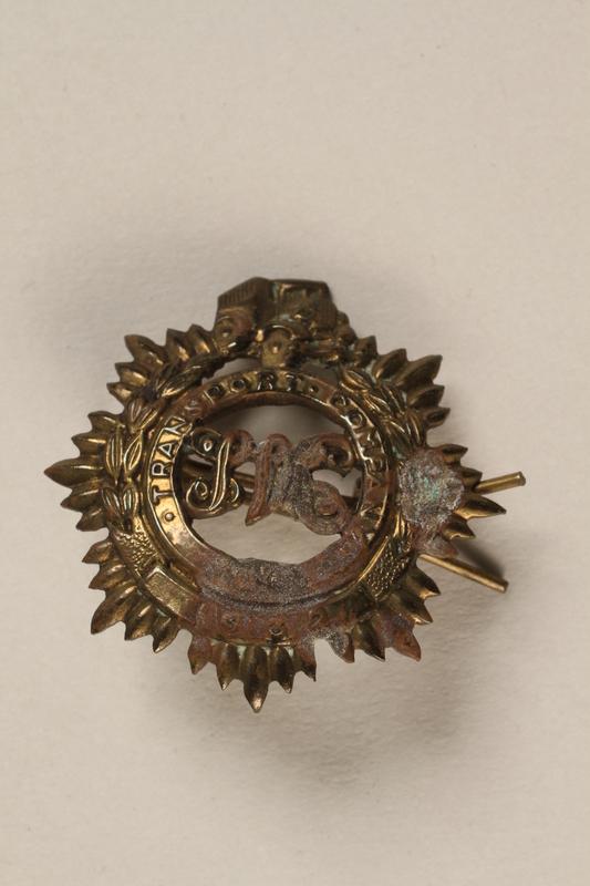 1989.243.273 front Shanghai Volunteer Corps badge