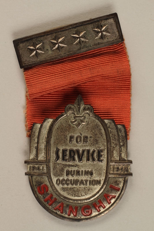 1989.243.71_b front Medal and a ribbon bar pin awarded by the British Boy Scouts to a Jewish refugee