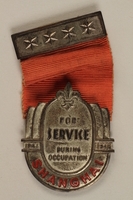 1989.243.71_b front Medal and a ribbon bar pin awarded by the British Boy Scouts to a Jewish refugee  Click to enlarge