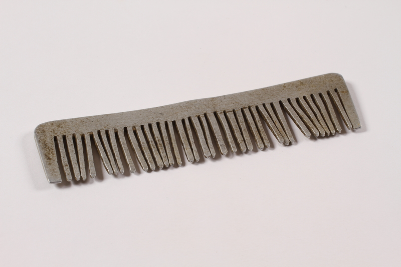 2013.379.8 left side Handmade metal comb used by a concentration camp inmate saved by getting on Schindler's list