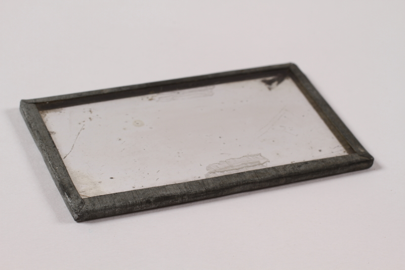 2013.379.9 front Pocket mirror used by a concentration camp inmate saved by getting on Schindler's list