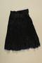 Black on black floral design cotton sateen skirt worn by a Romani woman