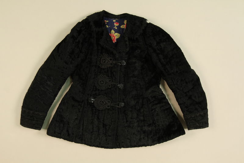1995.13.4 front Black jacket with plastic buttons worn by a Romani woman