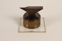 Anvil-shaped paperweight given to a US soldier serving as a displaced persons camp administrator