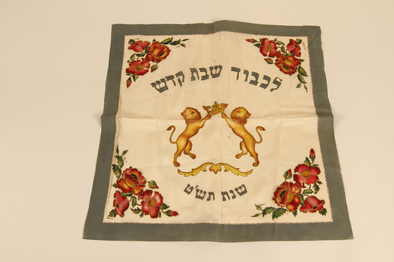 2012.443.4 front Challah cover with a handpainted crest of lions with a crown with a Star of David created by a Jewish Polish refugee in Bergen-Belsen DP camp