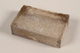 Unused brown soap bar with scratches imprinted RIF 0367