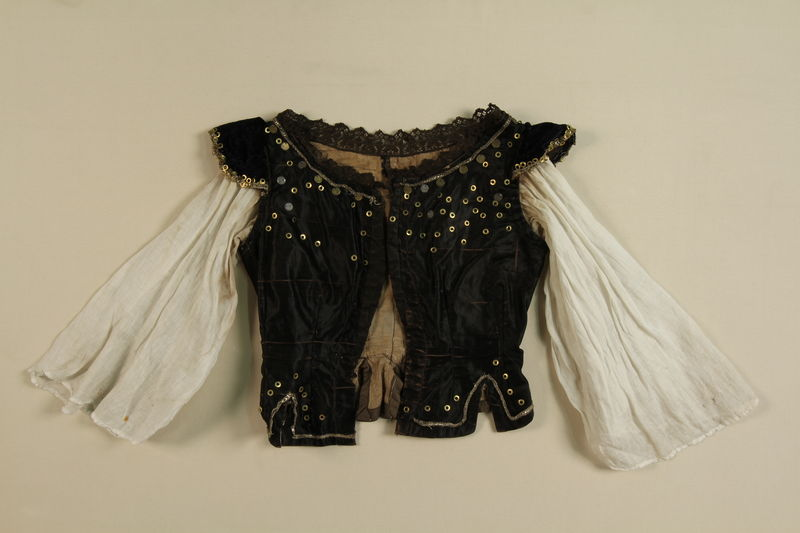 1989.270.1 front Black velvet embroidered blouse worn by a Lovari woman