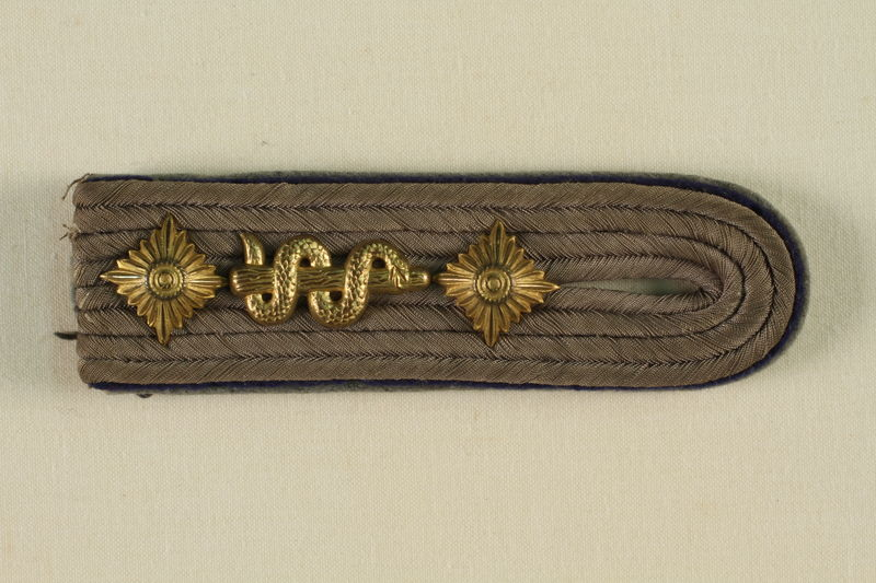 1995.142.10 front Shoulder board with starburst
