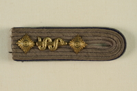 1995.142.10 front Shoulder board with starburst  Click to enlarge