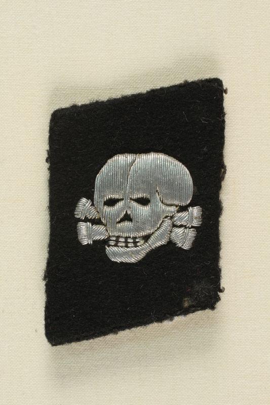 1995.142.13 front Nazi skull and crossbones badge