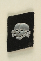 1995.142.13 front Nazi skull and crossbones badge  Click to enlarge