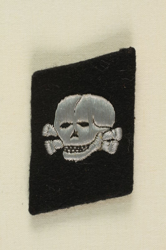 1995.142.14 front Nazi skull and crossbones badge