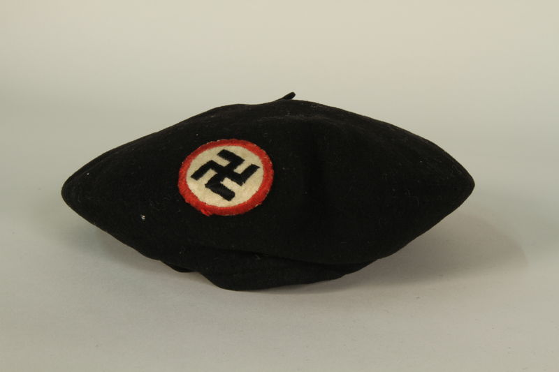 1995.142.24 front Black beret with a swastika patch
