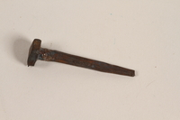 1989.270.7 front Hand-wrought horseshoe nail used by a Romani  Click to enlarge