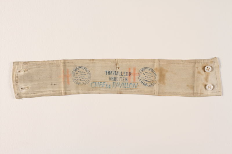 1995.144.2 front Travelling worker's armband