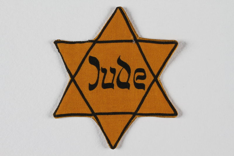 1995.145.1 front Star of David badge with Jude printed in the center