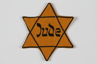 1995.145.1 front Star of David badge with Jude printed in the center  Click to enlarge