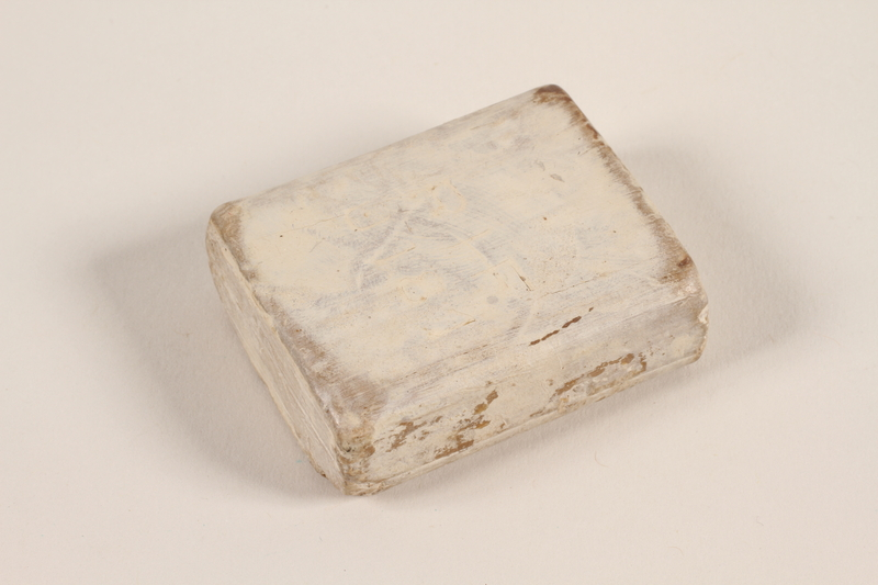 1995.15.1 front Soap issued to a concentration camp prisoner in Auschwitz-Birkenau