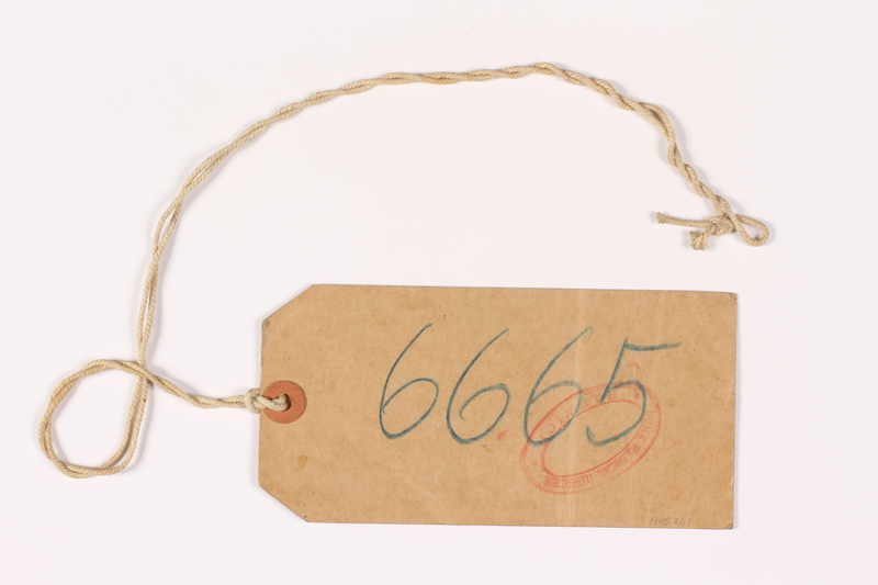 1995.21.2 back Luggage label used by a young girl on the Kindertransport