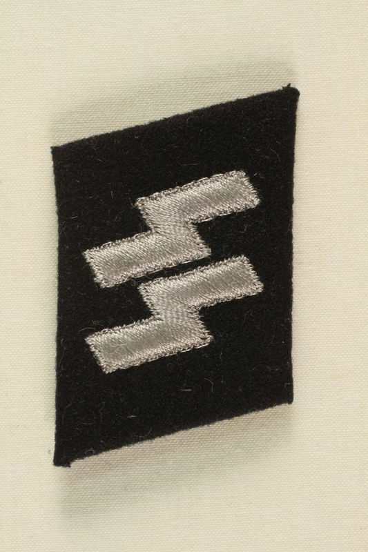 1995.32.2 front Stormtrooper badge worn by a high-ranking German SS Official