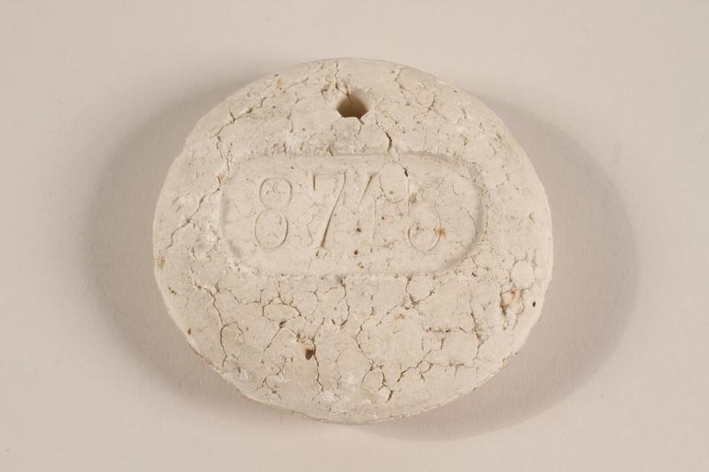 1995.37.1 front Crematorium tag