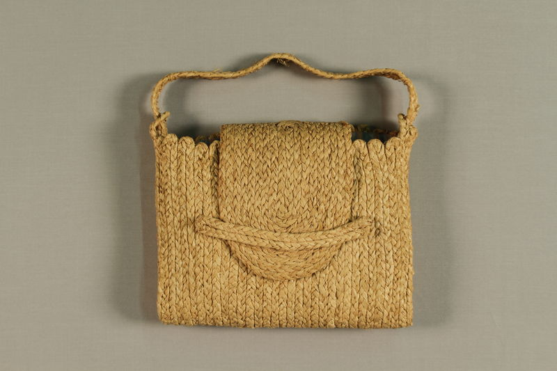 1989.273.1 front Handmade raffia bags made by a Jewish refugee woman